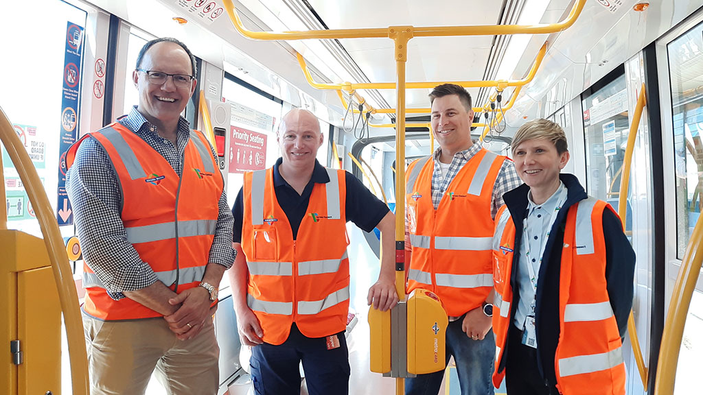 The Hon. Corey Wingard MP Minister for Infrastructure and Transport, Senior Tram Operator Paul Carruthers, Operation Manager Brett Andruszkiewicz, and General Manager Magda Robertson on board a tram