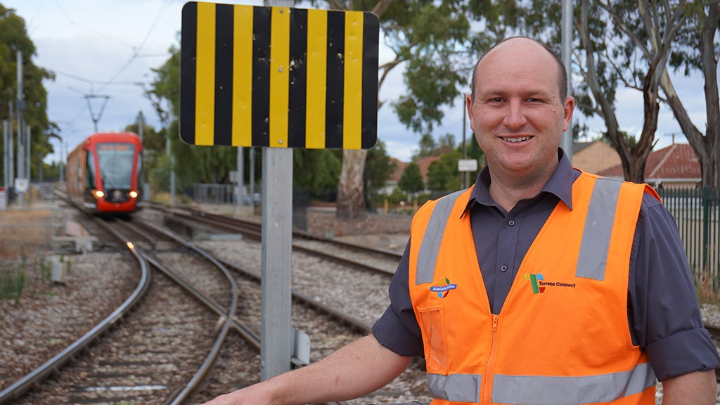 Rail Infrastructure Manager Tristan Smith with a tram in the background
