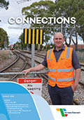 Cover of Connections newsletter showing a man in hi-vis with rail corridor in background