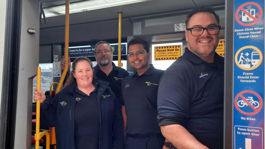Customer Service Officers in a tram doorway