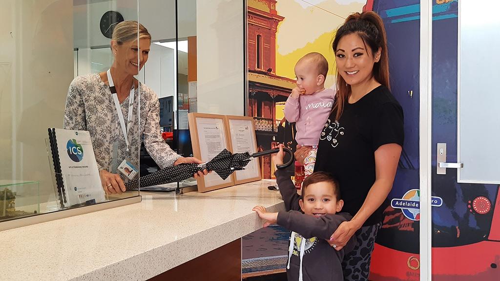 Customer experience staff returning a lost umbrella