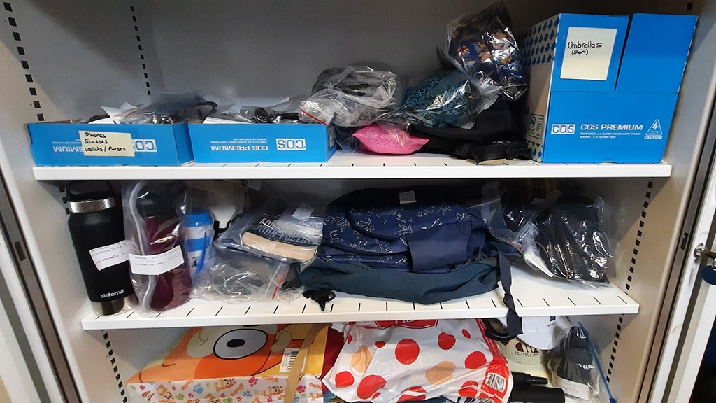 Recent items of lost property stored in a cupboard.