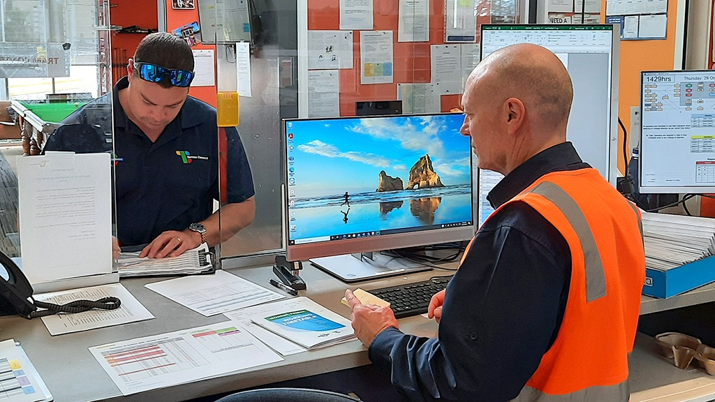 A tram operator handing in lost property at the Glengowrie depot.