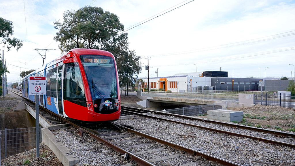 A tram travelling past the Glengowrie tram depot